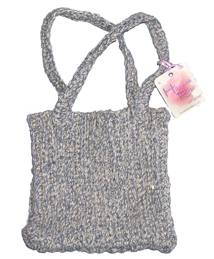 Crocheted square blue cotton tweed handbag with two handles.