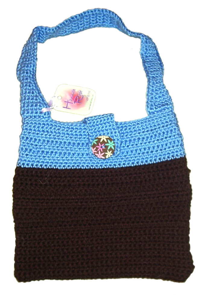 Blue and black crocheted handbag with floral button closure.