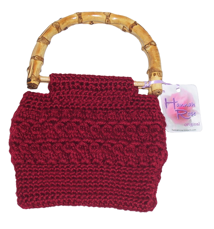 burgundy crocheted handbag with bamboo handles