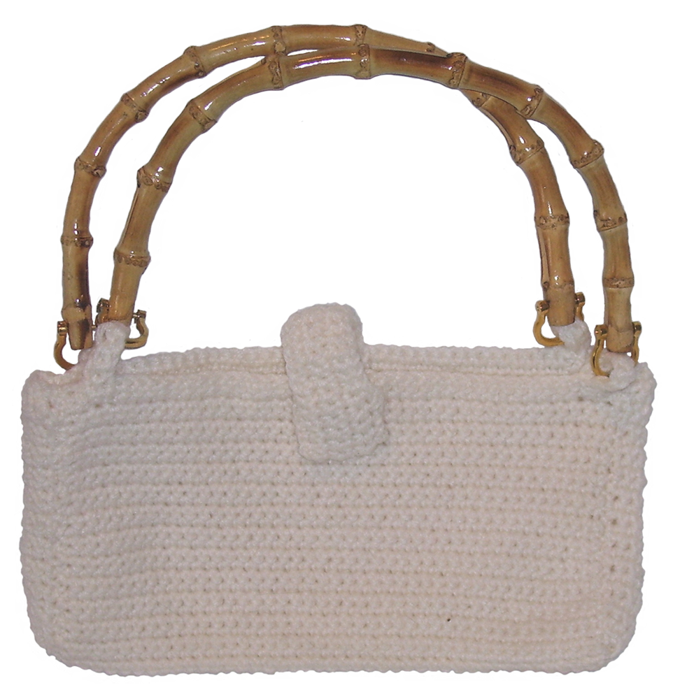 White crocheted handbag with magnetic closure and bamboo handles.